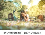 beautiful woman writing into...   Shutterstock . vector #1074290384