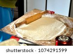 rolling out dough rolling pin... | Shutterstock . vector #1074291599
