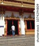Small photo of KHON KAEN, THAILAND - April 6, 2016: Tourist walking to Golden pagoda at Wat Nong Wang temple.