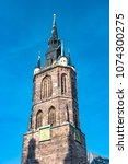 Small photo of View of Red Tower, Roter Turm, in Halle (Saale), Germany, blue sky, sunset