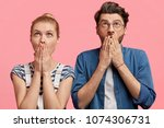 surprised couple looks with... | Shutterstock . vector #1074306731