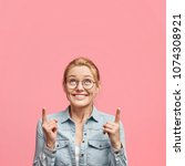 vertical shot of delighted... | Shutterstock . vector #1074308921