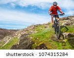 cyclist in red jacket riding... | Shutterstock . vector #1074315284