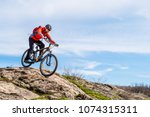 cyclist in red jacket riding... | Shutterstock . vector #1074315311