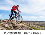 cyclist in red jacket riding... | Shutterstock . vector #1074315317