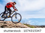 cyclist in red jacket riding... | Shutterstock . vector #1074315347