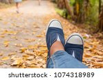hiking shoes young woman... | Shutterstock . vector #1074318989