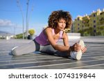 young woman doing stretching... | Shutterstock . vector #1074319844