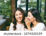 two asian women friends... | Shutterstock . vector #1074320159