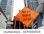 Small photo of Miami, USA - October 30, 2015: construction sign on city road. Road work ahead warning and safety. Transportation traffic and travel. Caution and warn concept.