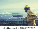 technician operating and... | Shutterstock . vector #1074325907
