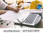 architect hands working on... | Shutterstock . vector #1074327899