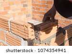 worker mason at construction... | Shutterstock . vector #1074354941