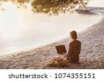 young woman using laptop... | Shutterstock . vector #1074355151
