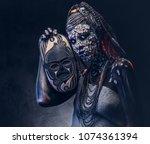 make up concept. portrait of a... | Shutterstock . vector #1074361394