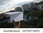 launch a paper airplane from... | Shutterstock . vector #1074371855