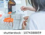 two scientist mix chemicals... | Shutterstock . vector #1074388859