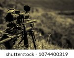 Small photo of Telescopic sight of a firearm, Detail of sniper weapon, death
