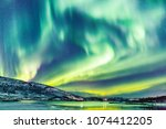 incredible northern lights... | Shutterstock . vector #1074412205