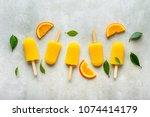 homemade popsicles with orange... | Shutterstock . vector #1074414179