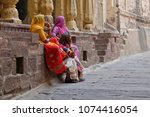 colors of india. women wearing... | Shutterstock . vector #1074416054
