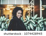 portrait of smiling young... | Shutterstock . vector #1074428945