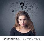 a pretty teenage girl standing... | Shutterstock . vector #1074437471