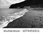 black beach of the village of...   Shutterstock . vector #1074453311