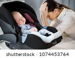 tired mother is sad near a... | Shutterstock . vector #1074453764