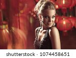 young fashionable lady posing... | Shutterstock . vector #1074458651
