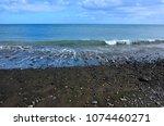 black beach of giniginamar...   Shutterstock . vector #1074460271
