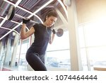 woman with barbell flexing... | Shutterstock . vector #1074464444