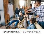 joyful students joining the... | Shutterstock . vector #1074467414