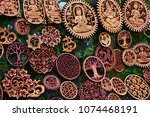 Traditional souvenirs and handicrafts of Bali at the famous Ubud Market. Hindu and Buddhist wooden carving in the outside wood-carver