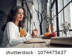 beautiful young girl in casual... | Shutterstock . vector #1074475637