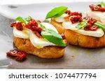 tasty savory italian appetizers ... | Shutterstock . vector #1074477794