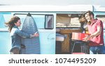 happy surfer couple camping in... | Shutterstock . vector #1074495209