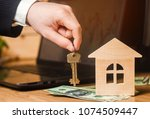 the hand holds the keys to the... | Shutterstock . vector #1074509447