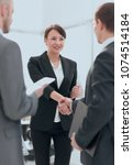 businesswoman shaking hands... | Shutterstock . vector #1074514184