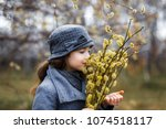 a girl in grey coat and a cute... | Shutterstock . vector #1074518117