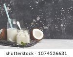 coconut yoghurt and coconut... | Shutterstock . vector #1074526631