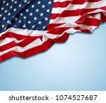american flag on blue background | Shutterstock . vector #1074527687