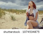 young woman on sand to...   Shutterstock . vector #1074534875