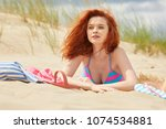 young woman on sand to...   Shutterstock . vector #1074534881