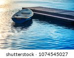 a boat tied to a wooden pier on ... | Shutterstock . vector #1074545027