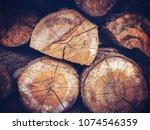 old pine logs retro filtered | Shutterstock . vector #1074546359