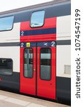 Small photo of Zurich, Switzerland - 3 March, 2017: a door of a railroad car of a passenger train of the Swiss Federal Railways. Swiss Federal Railways is the national railway company of Switzerland