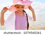 cute smiling girl in pink hat...   Shutterstock . vector #1074560261