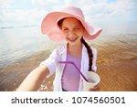 flirty little girl with drink...   Shutterstock . vector #1074560501