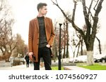 fashion young man on the street ... | Shutterstock . vector #1074560927